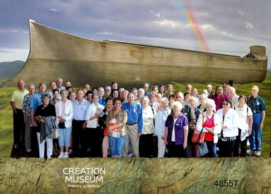 """We'll provide a formal way to sign up and pay soon . . . but below is information to help you plan. The group pictured was from our visit a few years ago. Date: Sat, Nov 12-Sun, Nov 13 Price $165, (covers deluxe motor coach, hotel accommodations, Creation Museum ticket, Planetarium ticket, Ark Experience ticket) Overnight stay at the La Quinta Inn, Florence KY, which includes: free warm breakfast, free internet, microwave and small refrig in each room, indoor pool, nice accommodations. ***My quote is based on at least two people per room (some rooms have two queens, others only a king, these will probably go to couples). If you don't want a roommate, the cost goes up $65 to $230. We will be boarding our motor coach at 6:15 am, from the far east lot (east of Dick's Sporting Goods) at Market Place Mall, Champaign, promptly leaving on or before 6:30 am. There may be a pick-up in or around Danville, TBD There may be a pick-up at the Beef House, TBD On sat, Nov 12, we'll go directly to the Creation Museum and stay until the 6 pm closing, then head to our hotel (dinner is on your own, as there are restaurants near hotel). Free hot breakfast at the hotel, Sunday morning. The Ark Experience opens at noon, so we may attend a local Church or hold service at the hotel, or allow for free time, TBD . . . and your input is appreciated. Leave the Ark around 4-5 pm, ET, arriving back home around 8-9:30 pm. Other things you should know: •Consider bringing along snacks, a sack lunch or other food items for the two days, if you so choose. The museums have restaurants where you may choose to eat at your own expense, and there are restaurants near the hotel. •Bring along a Bible, notebook, pen and camera. •Dress comfortably and casually, as it will be a long ride there and back. Maybe layer your clothing (weather dependant); you can leave things on our locked bus. •There will be sharing and testimony time on the bus, """"no pressure"""", but for those willing, consider sharing something that """